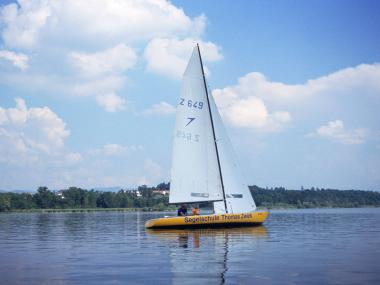 Sail boat of the sailing school Thomas Zwick on the lake
